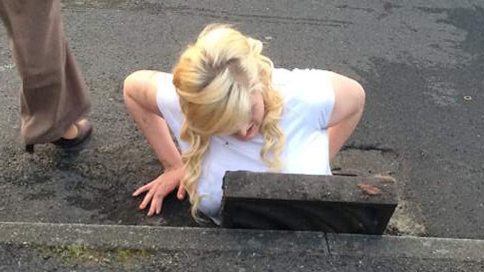 Girl stuck in drain