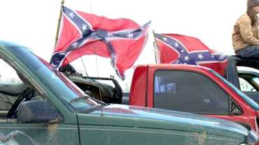 Supporters fly Rebel flags after the banning of the flags from the Waldron School District