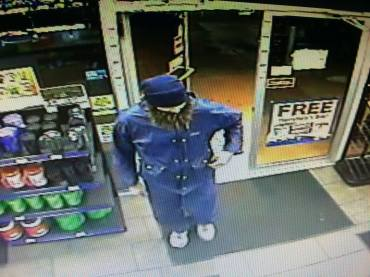 Surveillance video photograph showing the fake beard bandit during the Murphy USA robbery