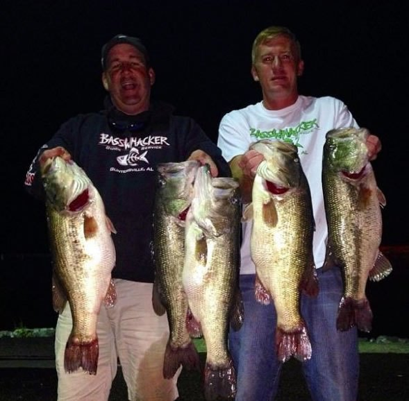 Photo of the two men holding a big catch (Courtesy: Wired2Fish.com, from one of the men's Facebook pages)