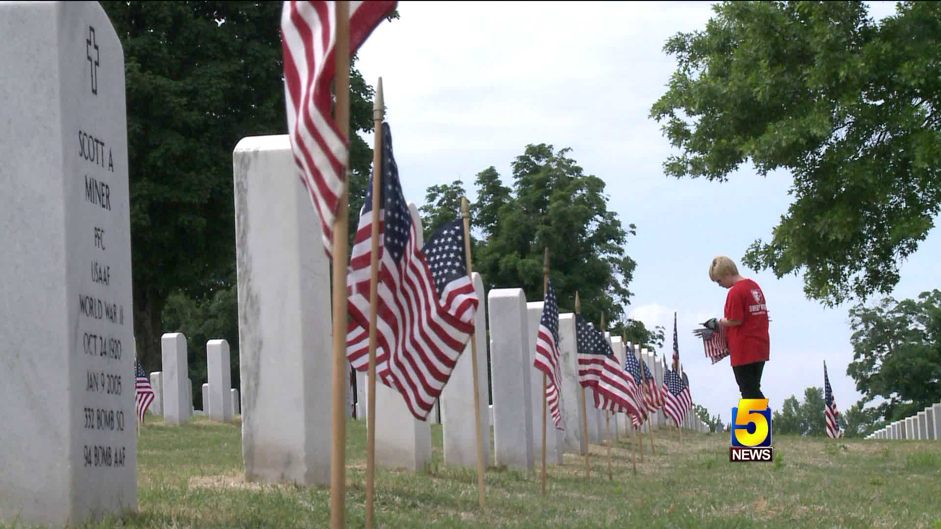 Flags placed on the graves at Springfield National Cemetery