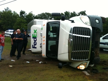 overturned fedex truck
