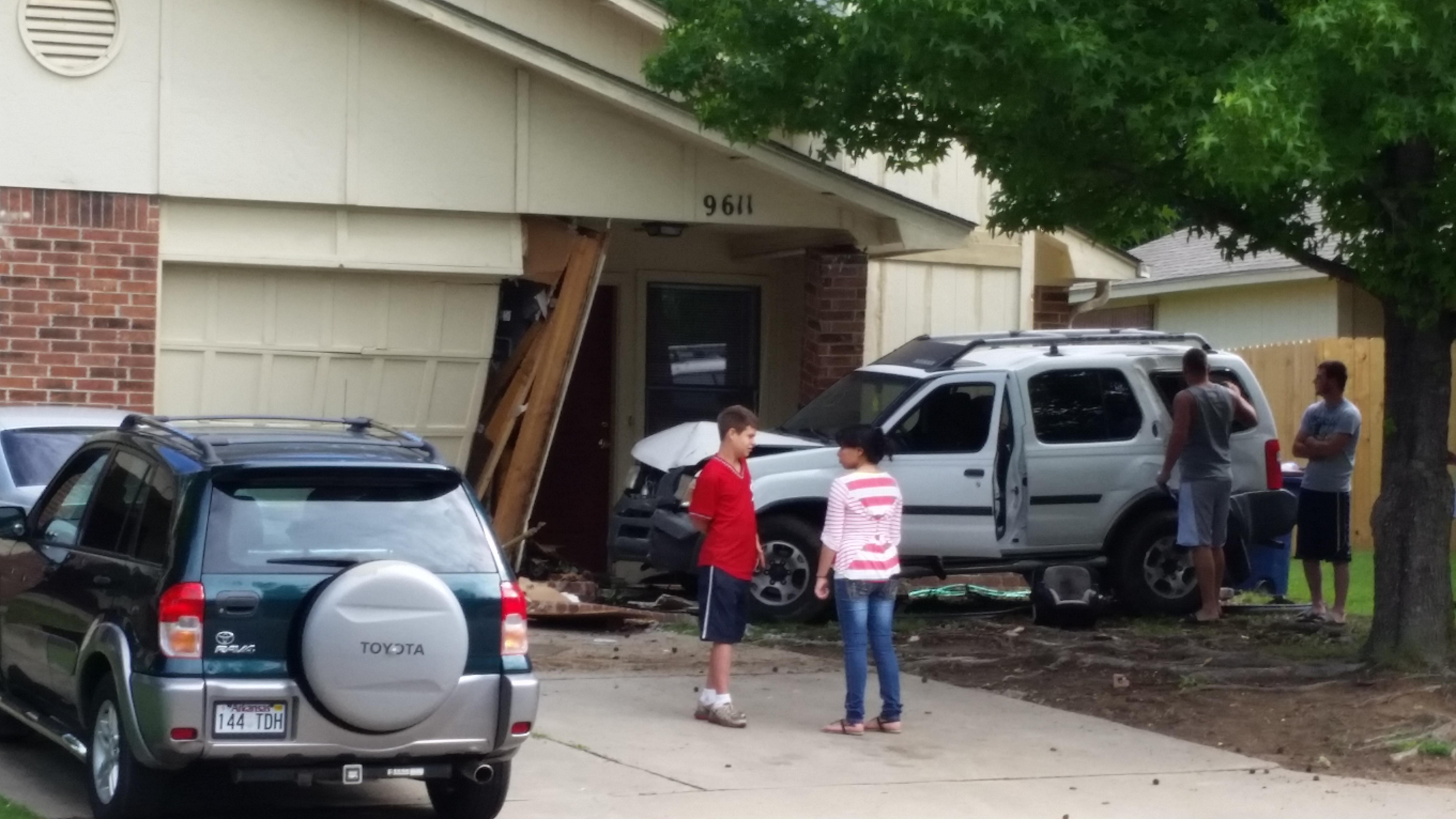 Car Slams Into House