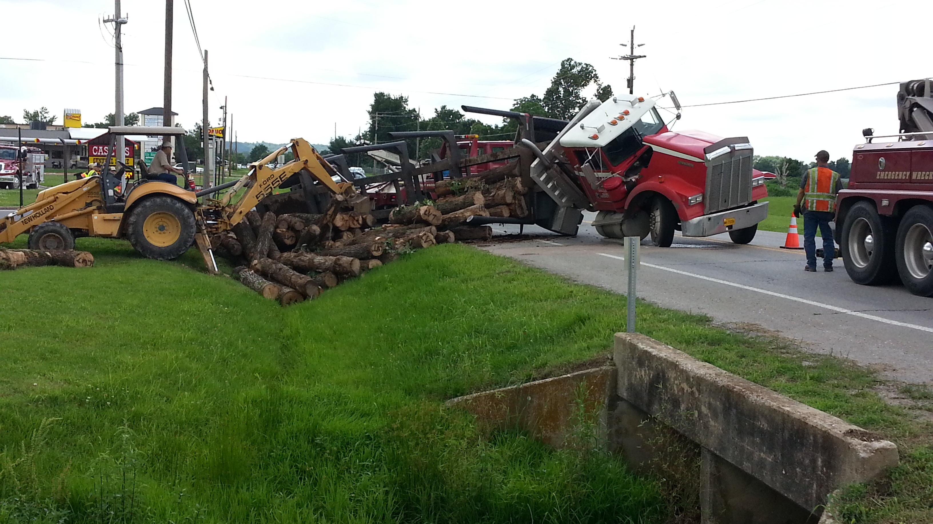 log truck overturned elkins