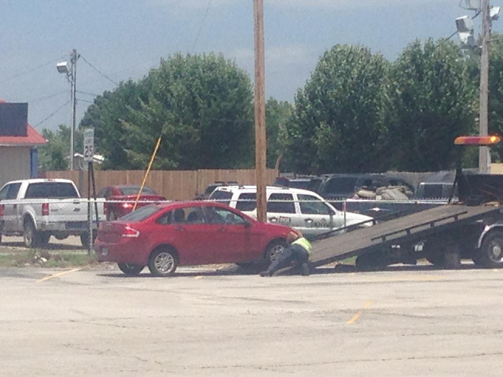 The suspect vehicle being towed following the suspect's arrest.