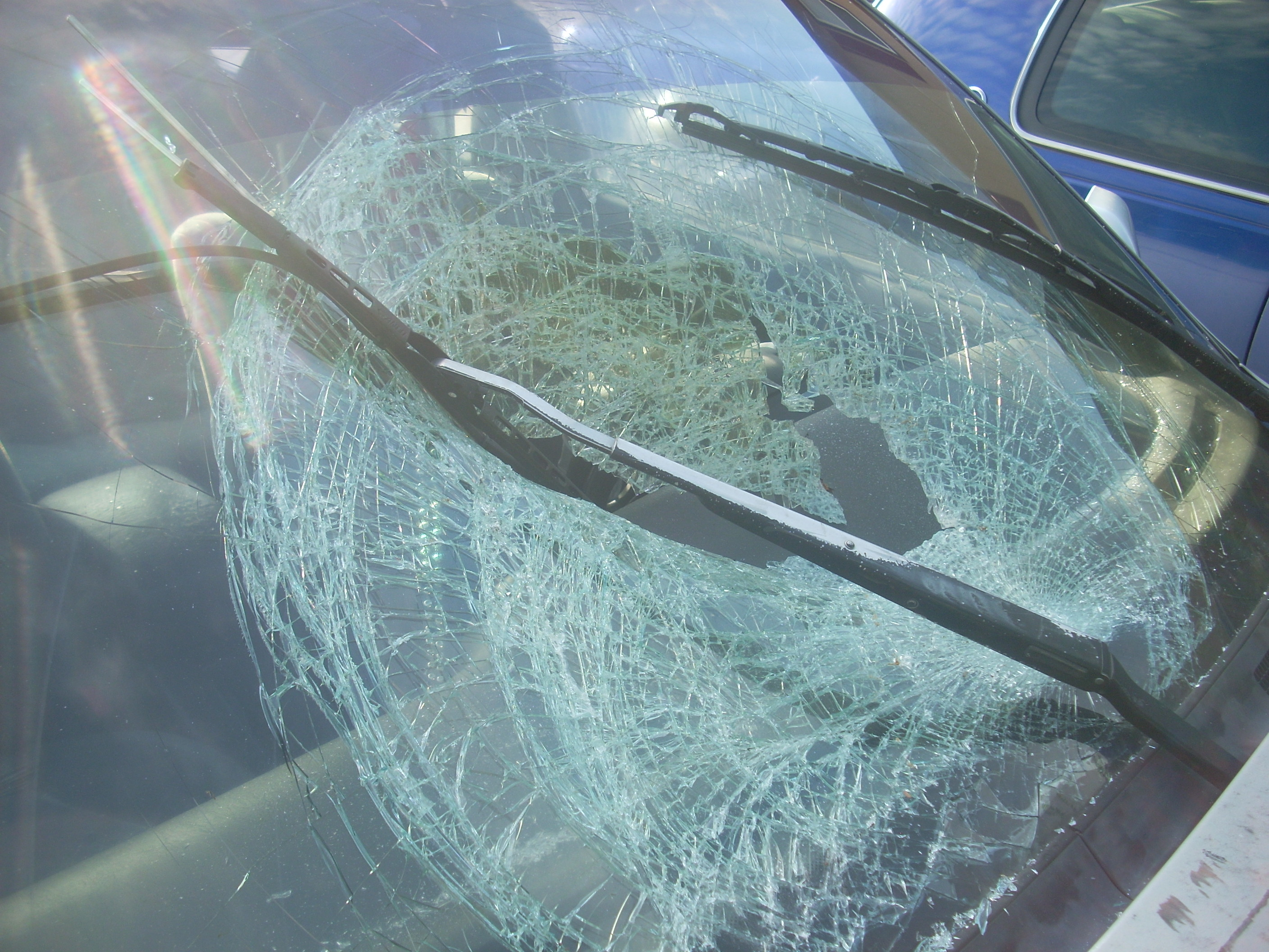 Photo of broken windshield from Fayetteville police