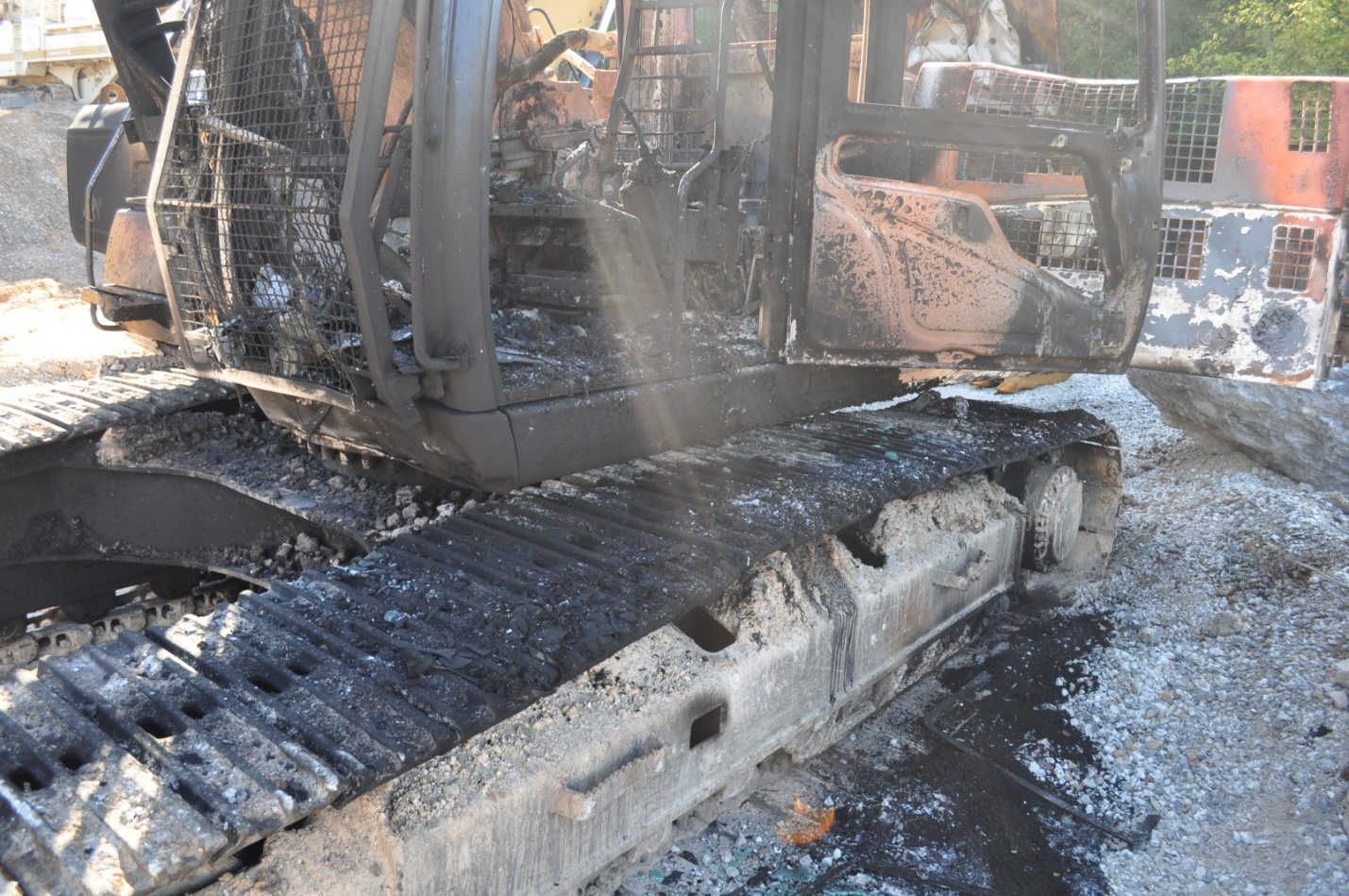 Destroyed construction equipment at the Bella Vista Bypass site.