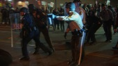 Protests in Ferguson, Missouri heat up after autopsy report of Michael Brown is leaked.