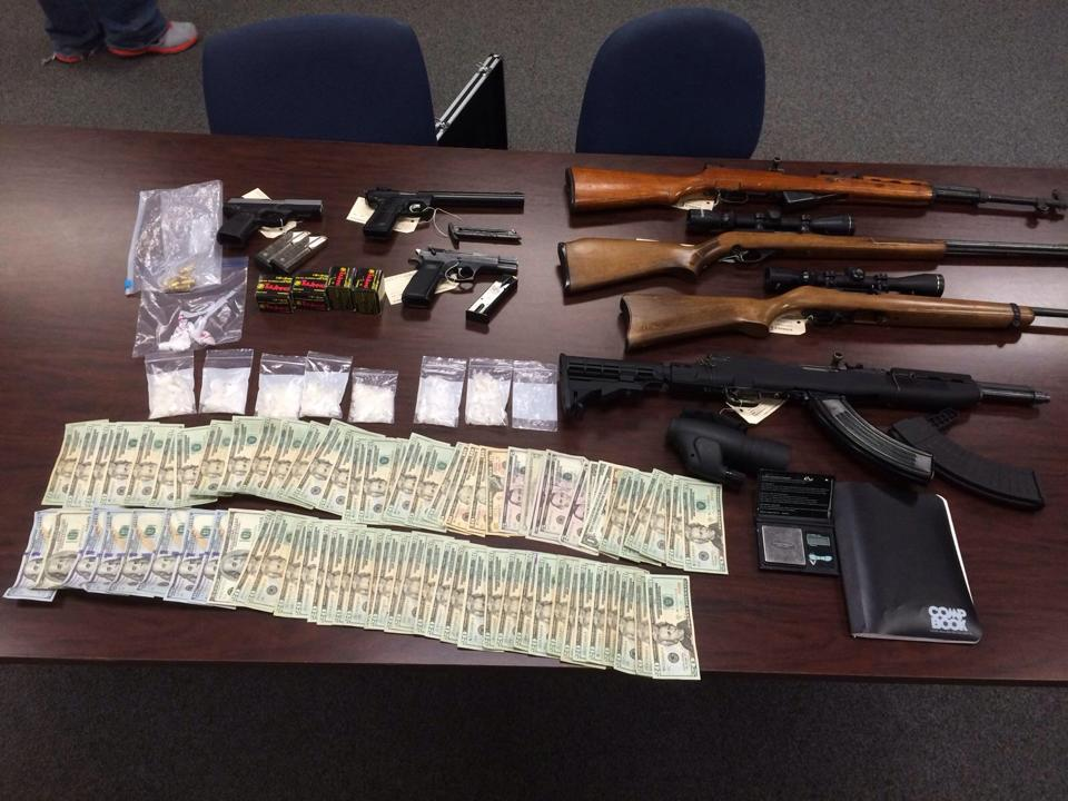 Methamphetamine, handguns, rifles and cash seized by the Benton County Sheriff's Office.