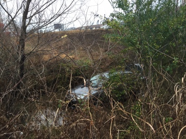 car in ditch greenwood