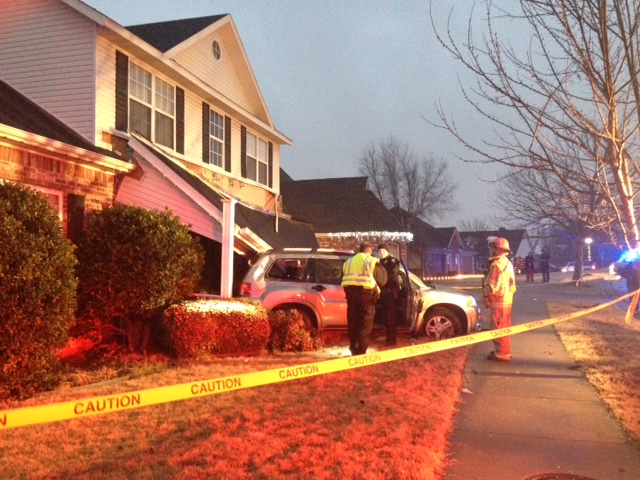 Vehicle flipped into porch in Springdale's Har-Ber subdivision.