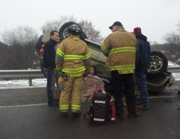 Medical crews tend to the female driver of this SUV that flipped on I-540 near the Rogers Avenue exit.