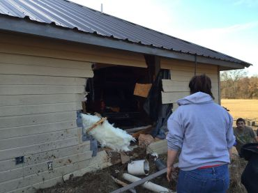 logan county car through house