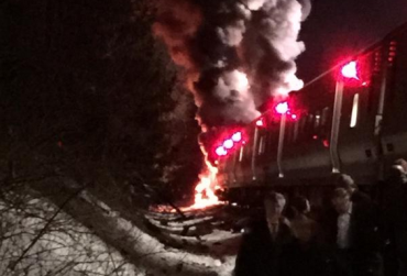 A Metro-North train in New York collides with two cars Tuesday night.