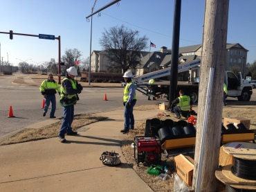 Workers install the new stoplight