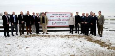 Representatives of the University of Arkansas System, Tyson Foods, WER Architects and Nabholtz Construction unveil a sign marking the future location of the Don Tyson Center for Agricultural Sciences. (Courtesy of Tyson)