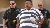 Mauricio Torres being walked into the Benton County Courthouse.