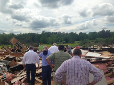 Governor Asa Hutchinson surveying the damage in Nashville from Sunday's EF-2 tornado with Congressman Bruce Westerman (Courtesy: Governor Asa Hutchinson Facebook page)