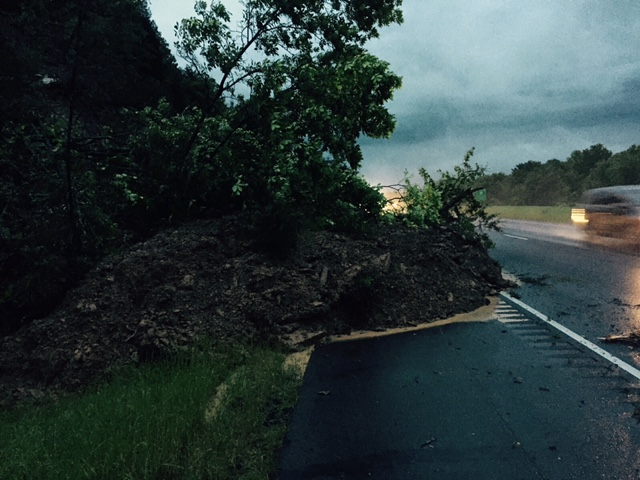 Hillside coming down on interstate between mile marker 46 other side of coal hill westbound side