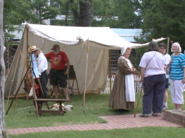 Courtesy KTHV. Volunteers dress up in 1836 era clothing in celebration of Arkansas' birthday.