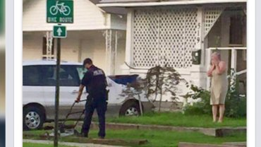 police officer mows lawn