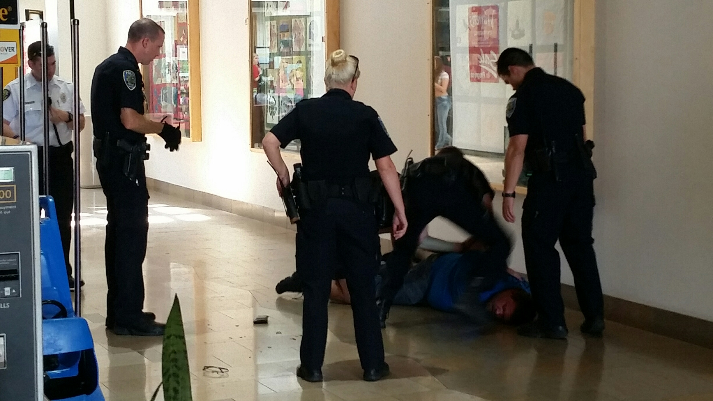 Police arrest one of the suspects at the NWA Mall.
