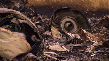 Personal belongings scattered in the ashes of the MH17 flight that crashed in Ukraine.