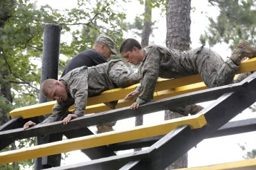 Army Soldiers participate in the Darby Queen obstacle course as part of their training at the Ranger Course on Ft. Benning Ga., June 28, 2015