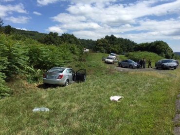 Virginia State Police provided this photograph of a Chevrolet Sonic along Interstate 66 in Northern Virginia that was driven by Vester Lee Flanagan on August 26, 2015. Flanagan shot and killed WDBJ reporter Alison Parker and photographer Adam Ward in Moneta, Virginia earlier in the day and crashed the vehicle in Fauquier County, more than 170 miles away from the scene of the shooting.