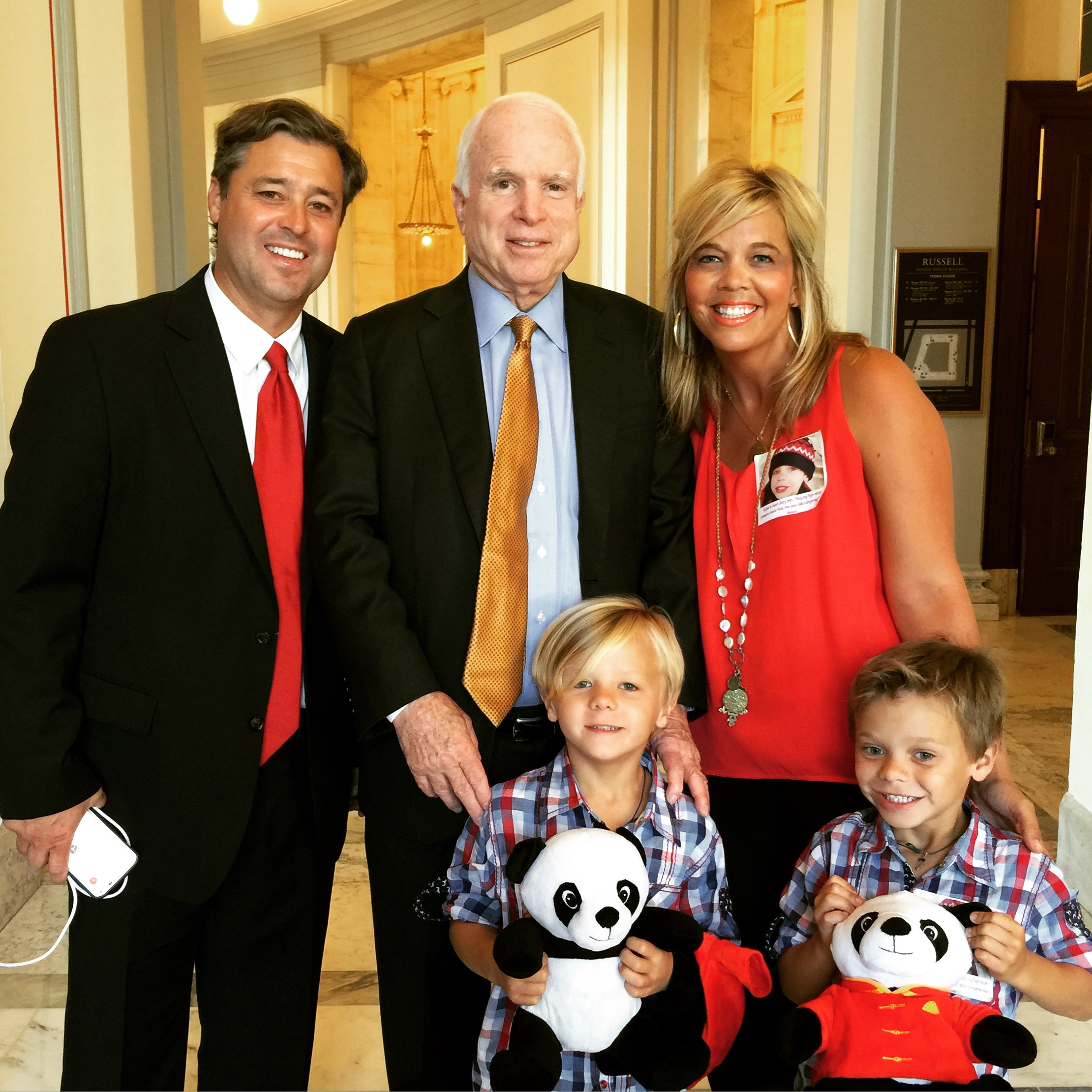 Ryder and his family with Sen. John McCain.