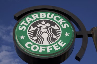 [FILE] A close-up photograph showing a Starbucks sign attached to a building located in Atlanta, Georgia.