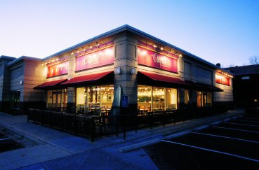 A nighttime exterior image of the Chipotle Mexican Grill  located in Highland, MN