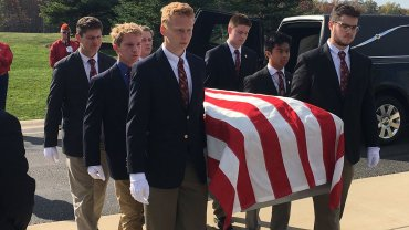 Michigan high school students volunteer as pallbearers for homeless veterans