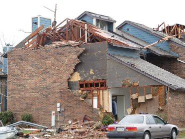 Photos showing damage to the Landmark at Lake Village West Apartments in Garland, Texas