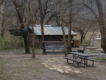 Picnic tables in trees at Tyler Bend Campground.