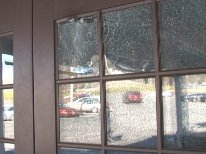 Bullet hole in the door of Red Lobster Courtesy THV 11