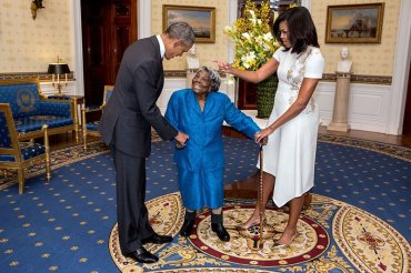 President Barack Obama and First Lady Michelle Obama greet 106-year-old Virginia McLaurin during a photo line in the Blue Room of the White House prior to a reception celebrating African American History Month, Feb. 18, 2016.