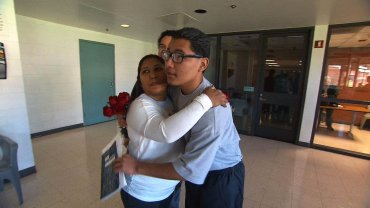 Carlos Adrian Vazquez Jr. hugs his mother, Adriana Garcia, in juvenile jail.