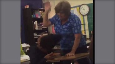 TEACHER HITTING STUDENT