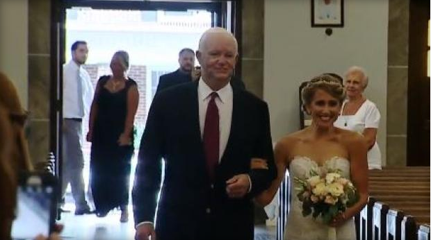 Heart recipient walks donor's daughter down the aisle