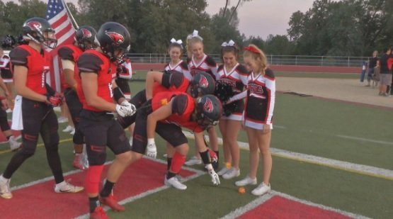 When a cheerleader from Foothill High School in Palo Cedro, California, was diagnosed with leukemia, her football family stepped up big time. One by one, all 57 members of the team laid an orange rose at Ashley Adamietz's feet before a game in September, 2016.