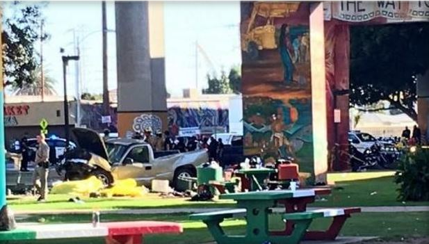 Four people killed and nine injured when truck plunges off bridge in San Diego.