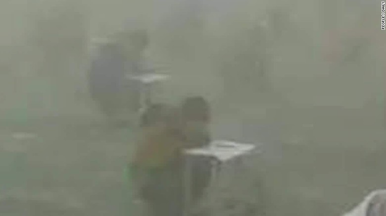 161221181241-china-students-take-test-surrounded-by-smog-walker-sater-00000811-exlarge-tease