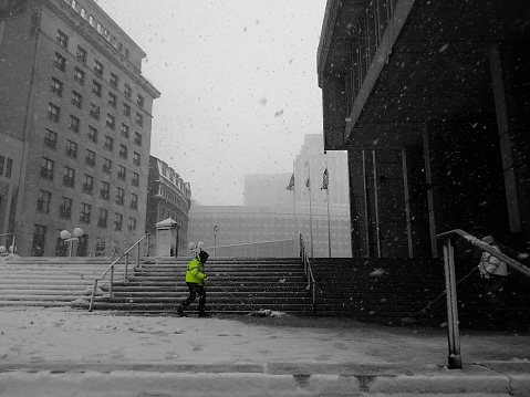 Cleaners At Boston City Hall During Snowfall (Getty)