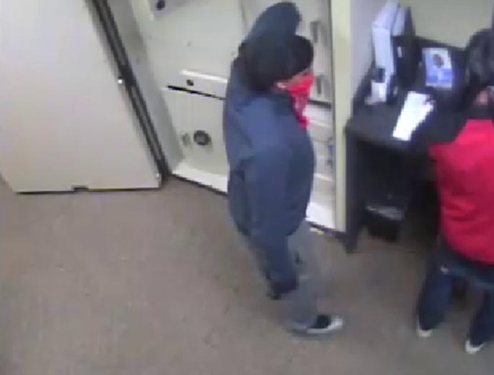 Surveillance camera image of the other robbery suspect.