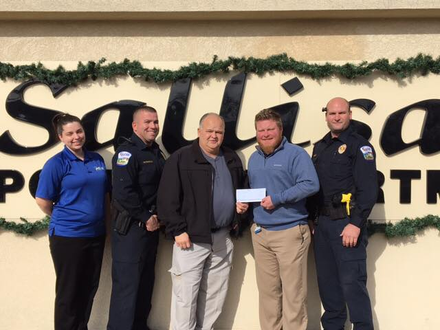 (Left to right): Jessica Robertson, civilian support services supervisor at Sallisaw Police Department, Lt. Herb Hutchinson also of the police department, Sallisaw Police Chief Terry Franklin, Store Manager Dustin Walters at Walmart and Officer Matt Ellis also of the police department.
