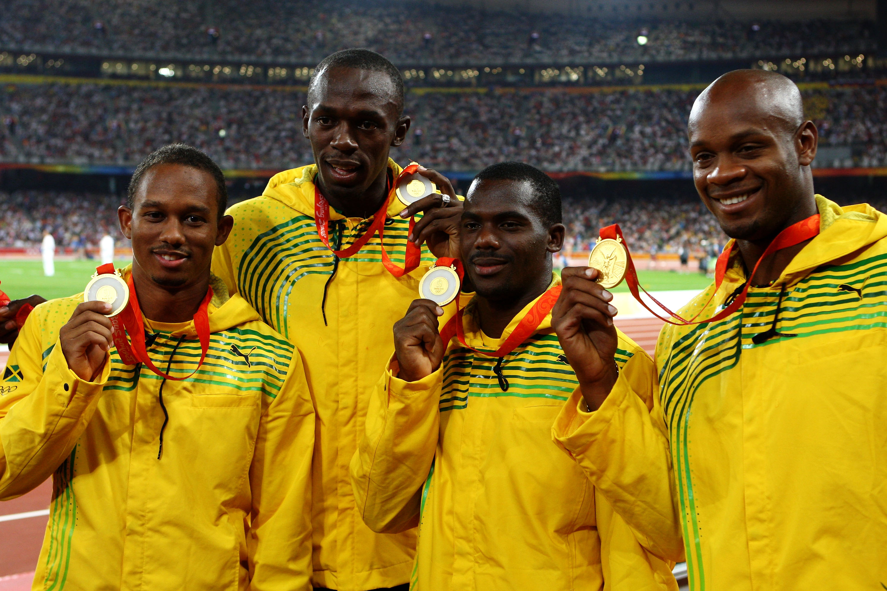 BEIJING - AUGUST 23:  (L to R) Michael Frater, Usain Bolt, Nesta Carter and Asafa Powell of Jamaica receive their gold medals during the medal ceremony for the Men's 4 x 100m Relay Finalheld at the National Stadium on Day 15 of the Beijing 2008 Olympic Games on August 23, 2008 in Beijing, China.  (Photo by Julian Finney/Getty Images)