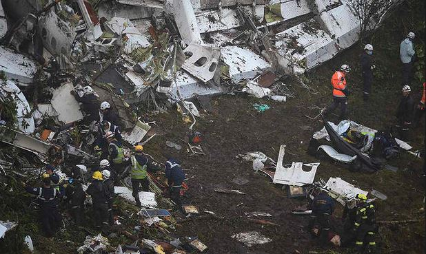 Emergency workers search the wreckage of the LaMia airlines charter plane after it crashed in the mountains of central Colombia. Getty Images.