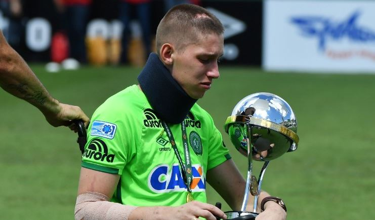Brazilian Chapecoense goalkeeper Jackson Follmann, a survivor of the LaMia airplane crash in Colombia, holds the Copa Sudamericana trophy. Jan. 21, 2017. Getty Images.
