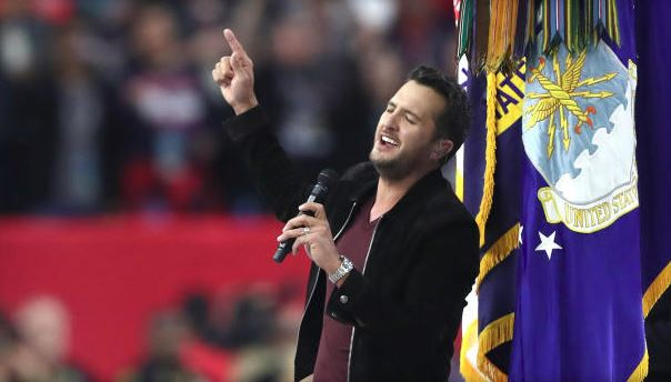 Luke Bryan sings the National Anthem prior to Super Bowl 51. (Getty Images).